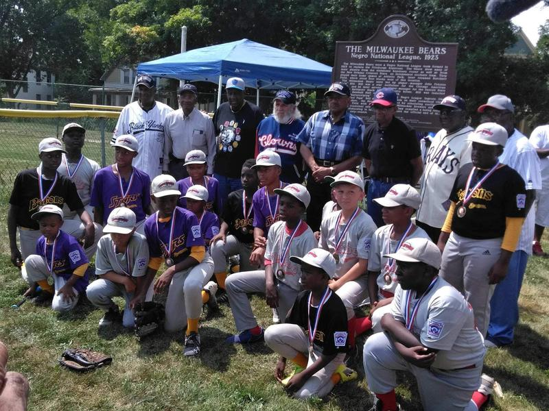 Beckum players pose for a photo with several Negro League players.