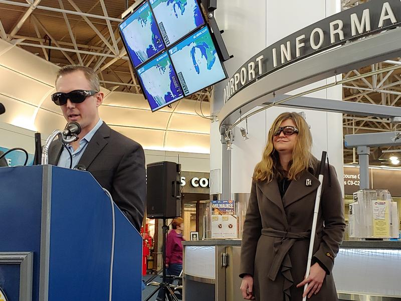 """Greg Stilson and Sarah Heesen wear camera-equipped """"smart glasses"""" at a Tuesday news conference at Milwaukee Mitchell International Airport"""