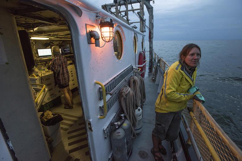 Journalist Kari Lydersen aboard the School of Freshwater Sciences research vessel, the Neeskay.