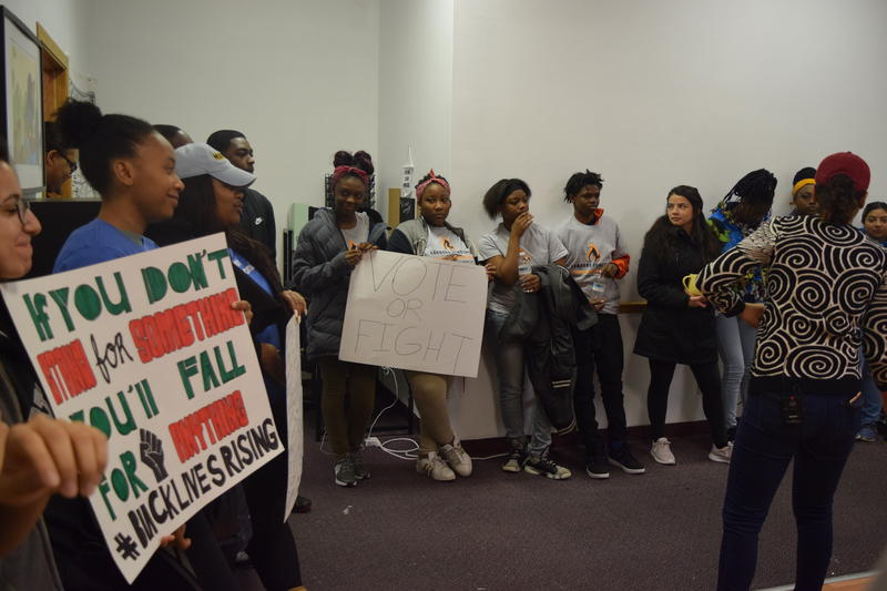 Members of LIT and NextGen Wisconsin rally before heading out to canvas Milwaukee neighborhoods.