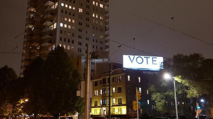 A billboard at the corner of Farwell and Ogden Avenues in Milwaukee says, simply, vote.