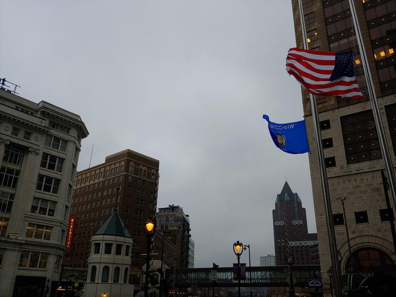 Blustery conditions at midday Thursday prompted Riverwalk lights to be on, and flags to blow.