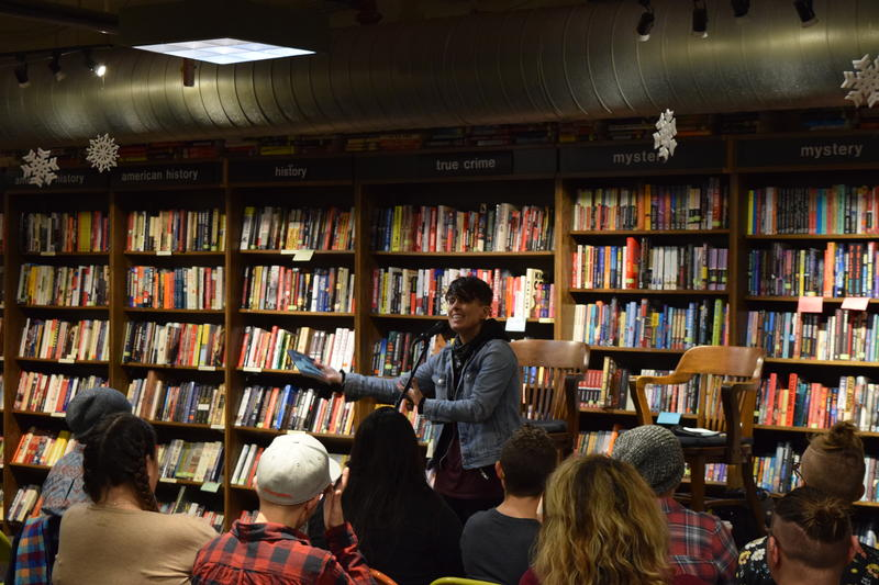 Spoken word poet Andrea Gibson in front of an audience at Boswell Book Company.