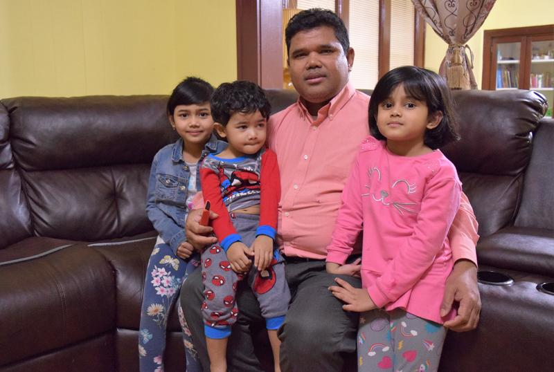Anuwar Kasim and his three children in their Milwaukee home. Kasim is co-founder of the Burmese Rohingya Community of Wisconsin, a nonprofit in Milwaukee. Kasim is a Rohingya refugee who has been in Milwaukee since 2015.