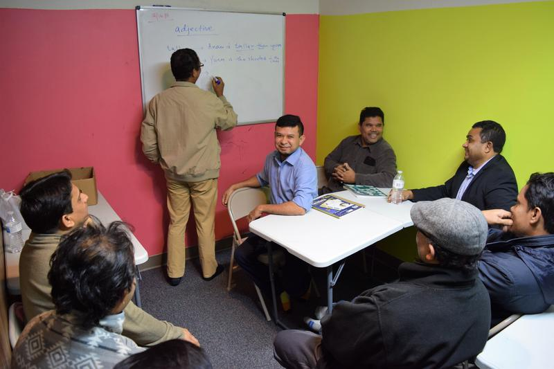 Rohingya refugees gather for an English language class at the Burmese Rohingya Community of Wisconsin.