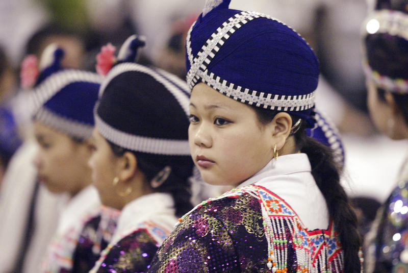 A young woman wears a traditional Hmong outfit at the Hmong New Year Celebration at the Wisconsin State Fair Dec. 11, 2004 in West Allis, Wis.