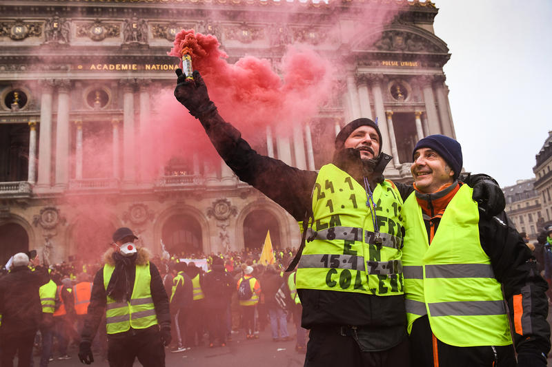 Protesters gather at Place de l' Opera during the 'yellow vests' demonstration on December 15, 2018, in Paris, France.
