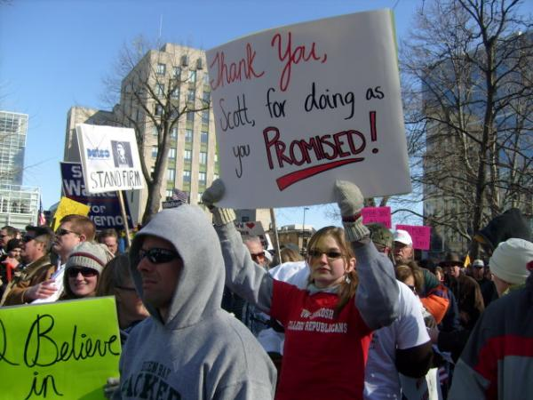 A woman demonstrates in Madison in support of collective bargaining changes proposed by the Governor.