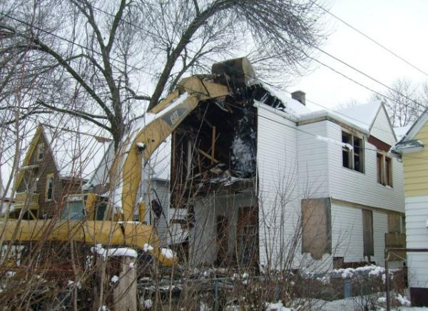 It costs about $15,000 to demolish a house, and takes 2-3 days to remove the debris, leaving the lot ready for redevelopment.