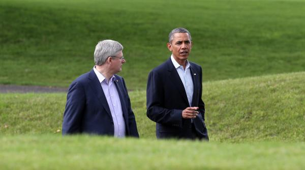 President Obama speaks with Canadian Prime Minister Stephen Harper while attending the G8 summit in Northern Ireland.