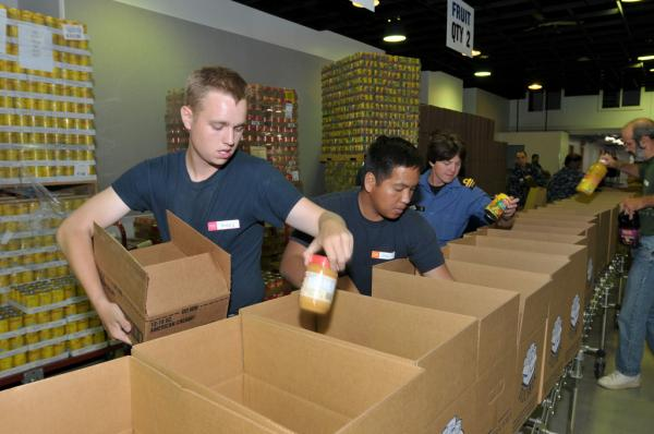 Members of the Navy volunteer at Milwaukee's Hunger Task Force.
