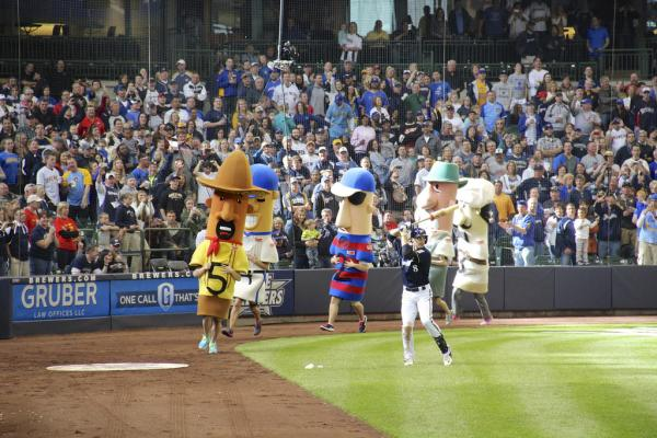 All five of the Klement's Famous Racing Sausages race around the bases at Miller Park Stadium. Originally there were only three mascots.