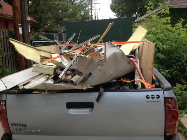 Tim Nelson takes his truck scrapping in an alley of Sherman Park.