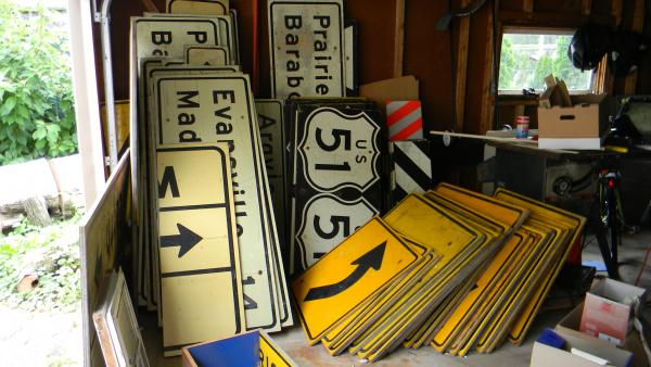 """The highway signs that """"patched"""" the home Carol Bracewell bought"""