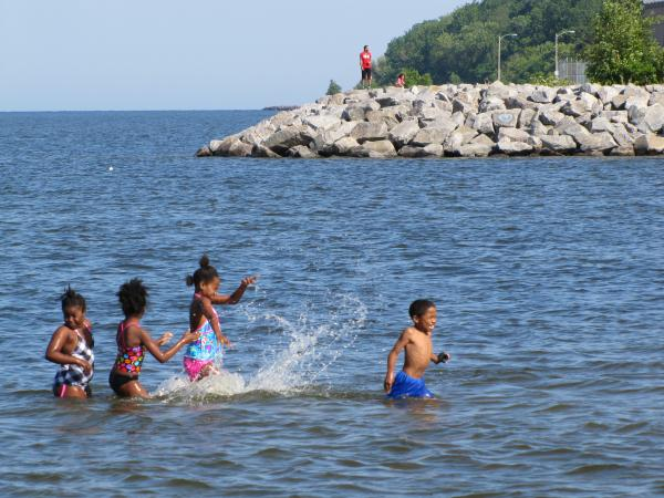 Kids enjoying South Shore Beach just a day after it was closed due to contamination concerns.