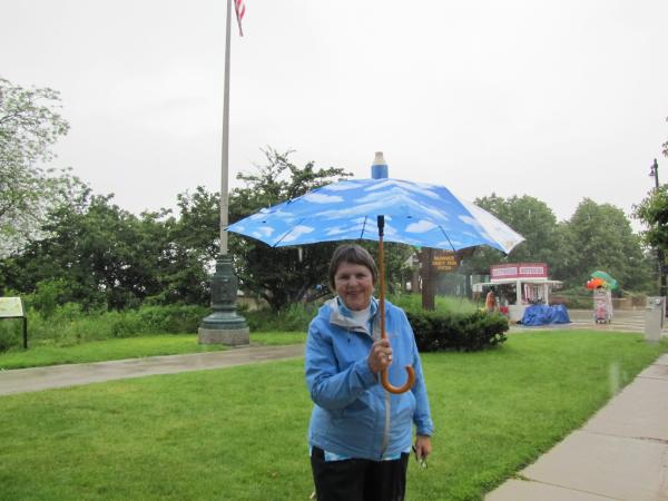 Diane Buck explains significance of the memorial flagpole behind her.
