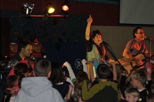 Nathan Meckel (center) of The Happy Racers performs for fans, young and old.
