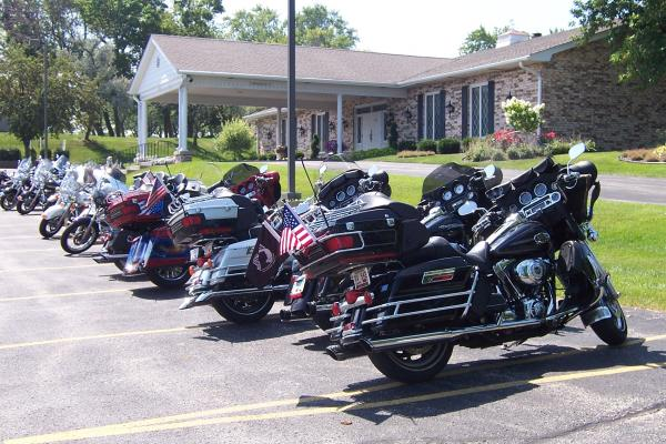 Harley riders park their bikes outside Max Sass and Sons funeral home on S. 60th Street.
