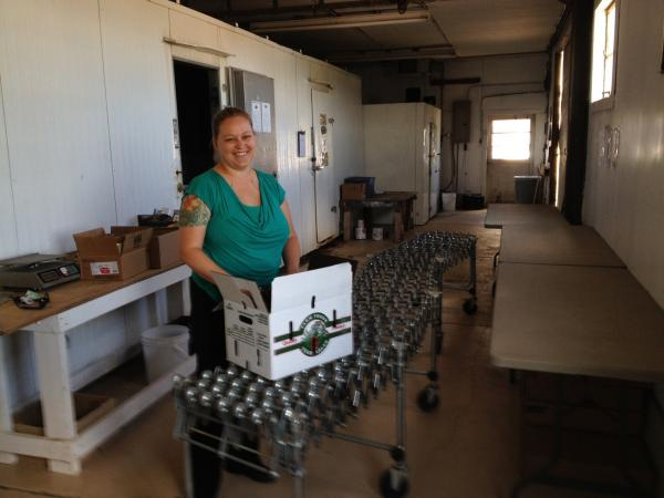 Kelly Westlund inside Lake Superior CSA aggregation and distribution central.
