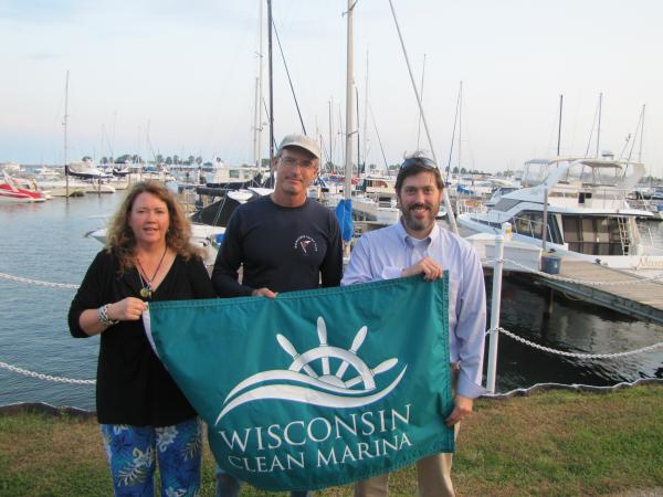 Wisconsin Clean Marina program manager Kae Donlevy joins marina manager Dan Couillard and Coastal Management's Todd Breiby to celebrate Milwaukee Yacht Club's Clean Marina celebration.