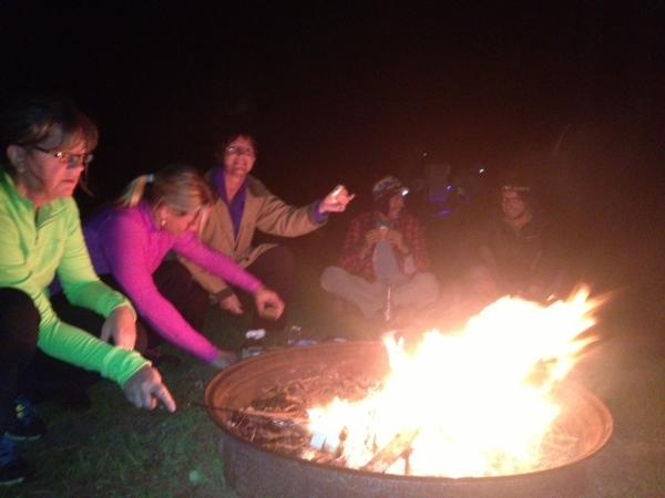 Three hikers (left) share campfire and stories with Paddle Forward crew at Belle Prairie County Park in Minnesota.
