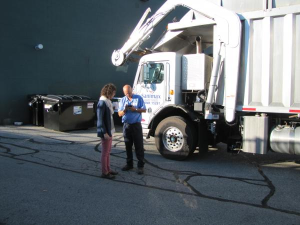 Jessy Servi reviews Outpost's compostable contribution with hauler Mike Collins.