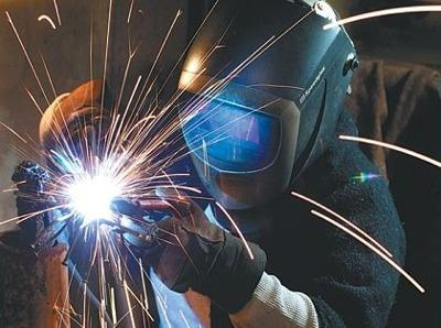 Metal artist Erika Koivunen at work with her welder