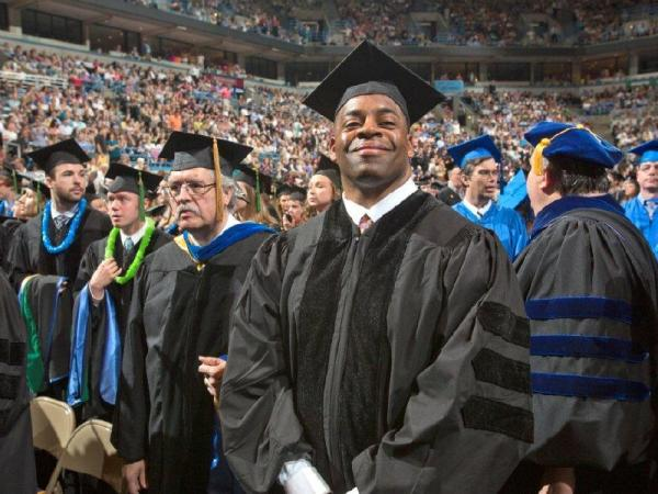 Former NFL player George Koonce received his Ph.D. from Marquette University.