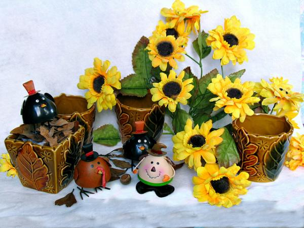 Contained plants can be adorned with fall decorations.