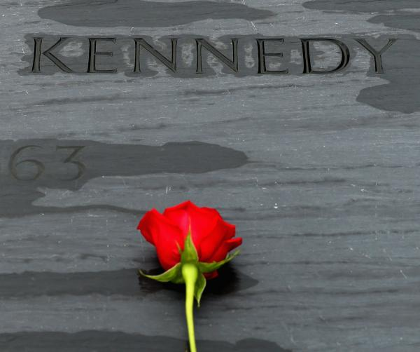 A wreath-laying ceremony is held at Arlington National Cemetery at U.S. President John F. Kennedy's grave marker. This rose was left by family members.