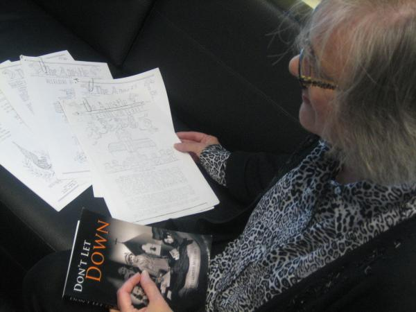 """Milwaukee author Betty Mullins with copies of """"The Apostle,"""" a parish newsletter edited by her mother and other young women during WWII. It was sent to soldiers fighting abroad."""