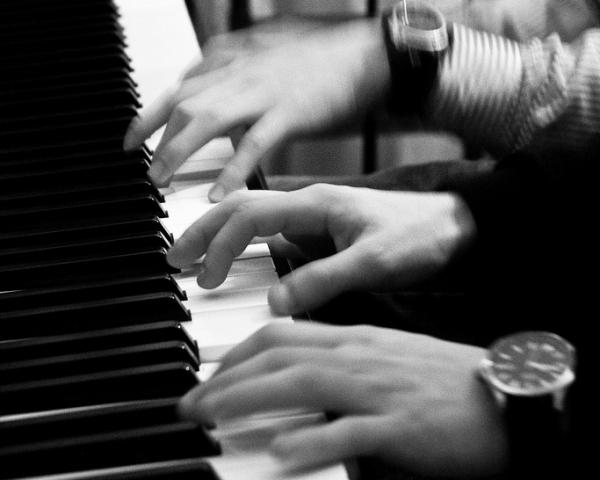 Four hand music requires two pianists playing on one piano.