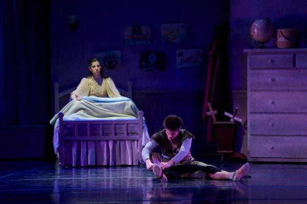 """Wendy watches as Peter sews his shadow back on in the Milwaukee Ballet's production of """"Peter Pan."""""""