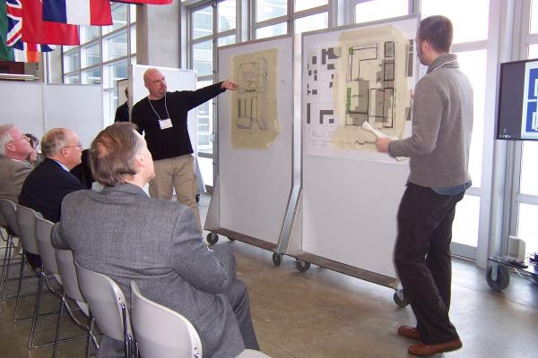 Architects present plans for the Bronzeville neighborhood at Monday's charette.