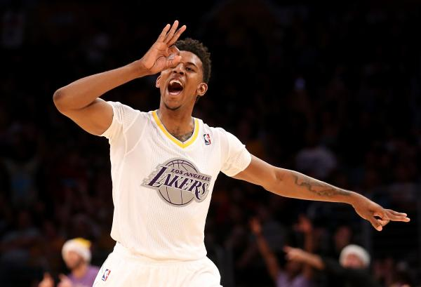 Nick Young of the Los Angeles Lakers celebrates after making a three point basket against the Miami Heat at Staples Center on December 25, 2013.
