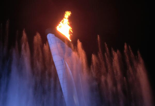 The Olympic Torch is lit during the Opening Ceremonies at the 2014 Winter Games in Sochi, Russia.