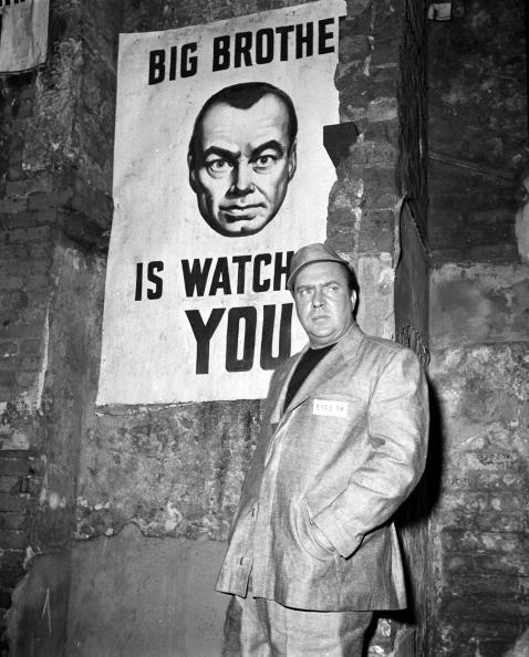 """American actor Edmund O'Brien is pictured in a scene from the film """"1984"""", based on the book by George Orwell (Stepney, London, England. 1955)."""