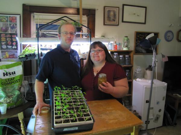 Joey and Holly Baird stand ready to transplant tray upon tray of sprouting vegetables outside as soon as spring takes hold.