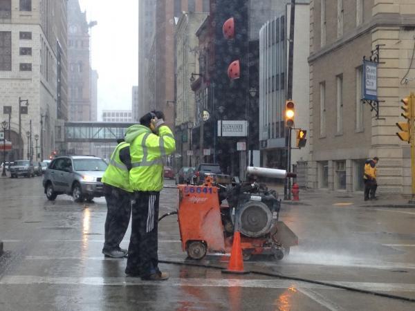Crew tending to pothole in downtown Milwaukee