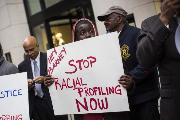 Tyreik Jackson protests outside Barney's flagship store, accusing the store of racial profiling, on October 30, 2013 in New York City. On April 29, 2013 Trayon Christian, 19, was detained and then arrested by undercover police after buying a $349 belt at Barney's.