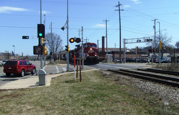 A Canadian Pacific locomotive approaches a crossing at 68th and State in Wauwatosa.