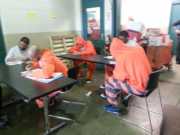 Inmates take the forklifting exam at the House of Correction.