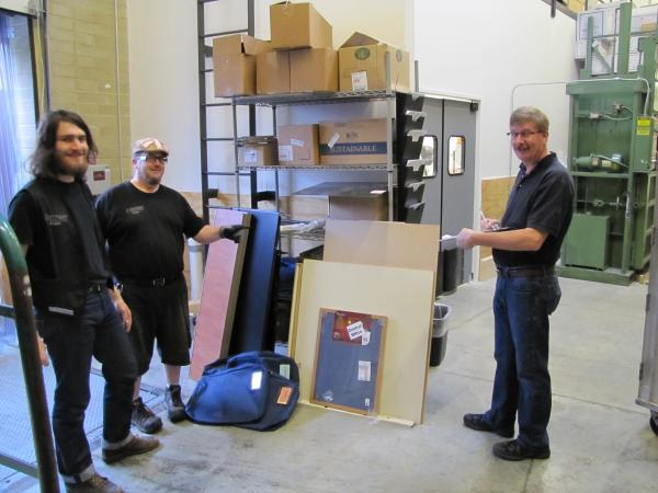 Receiver Ryan Miracle (left) truck driver Andy Pagel and store manager Tom Knueppel prepare for opening day.