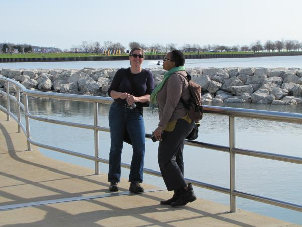 Great Lakes explorer Loreen Niewenhuis (facing camera) meets a fellow Lake Michigan fan on Milwaukee's lakefront.