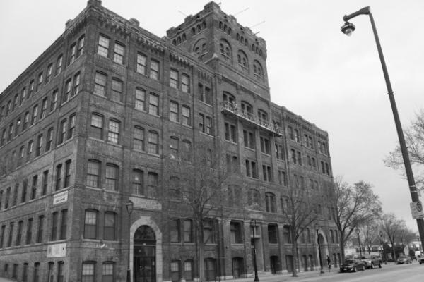 "Aimee Robinson's latest ""Intersections"" blog post features the F. Mayer Boot and Shoe Co. building."