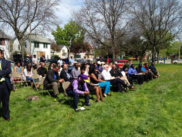 Residents at a north side Milwaukee park listen to a discussion about efforts to increase opportunities for black men in the city.