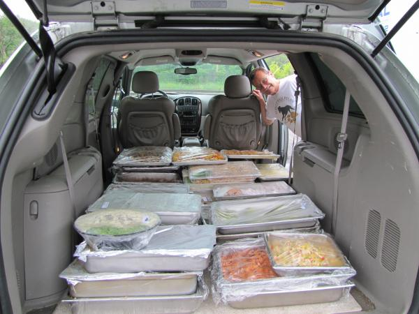 Chris Capper with load of leftovers from Saz's Catering.