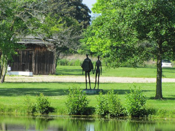 A glimpse of sculpture found on the Garden grounds - The Lovers by Lindsay Daen