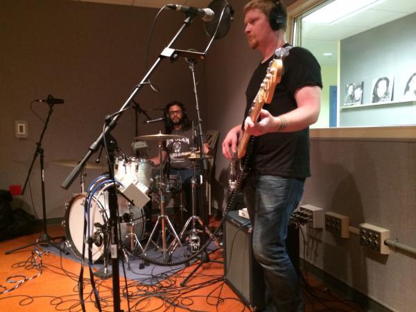 Kavi Laud on drums and Jeff Brueggeman on bass guitar.