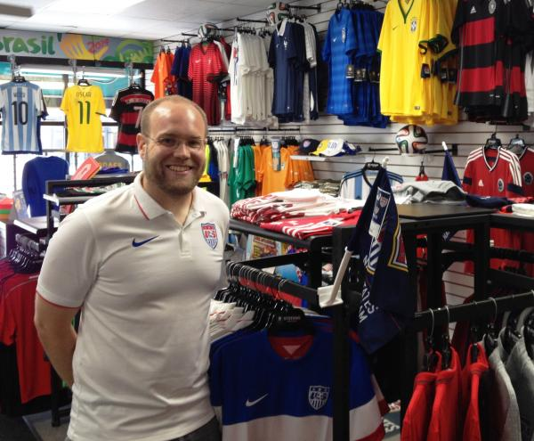 Dustin Aubert picks out merchandise for Stefan's four stores. He's watched the supply of Team USA items at the Lincoln Avenue location, shrink, during World Cup.